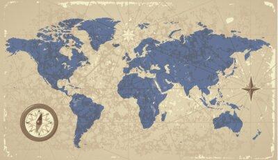 Carte du monde rétro-disant avec boussole