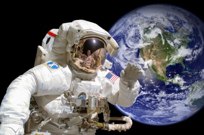 Sticker Close up of an astronaut in outer space, earth in the background - elements of this image are provided by NASA