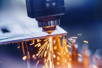Sticker CNC laser machine cutting sheet metal with light spark. Technology plasma industrial, Blue steel color