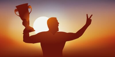 Concept du succès avec un sportif qui savoure sa victoire en brandissant le trophée gagné lors d'une compétition sportive et en faisant le signe de la victoire.