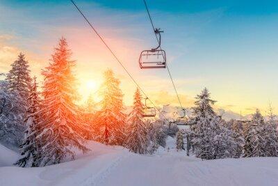 Sticker Coucher de soleil dans paysage hivernal dans les montagnes Alpes juliennes