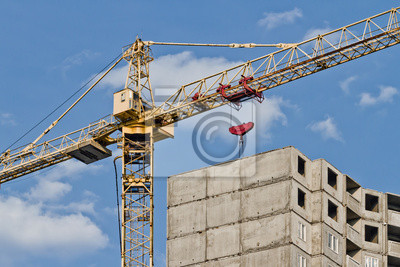 Crane and house under construction