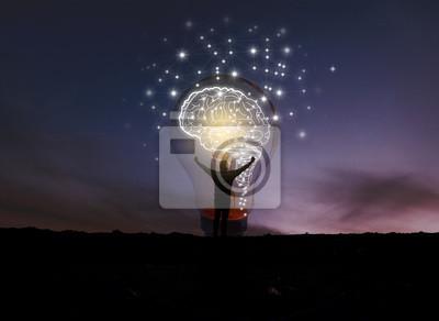 Sticker creative idea.Concept of idea and innovation / night sky background / soft focus picture / Blue tone concept