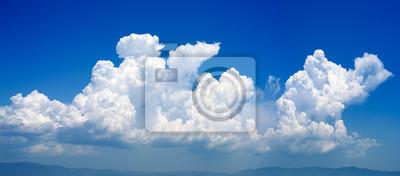 Sticker cumulonimbus nuage dans un ciel bleu profond