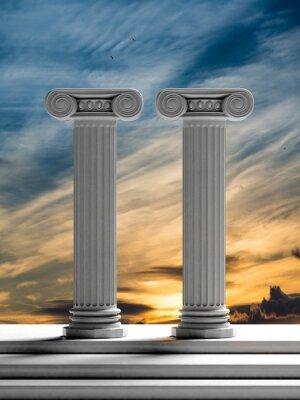 Sticker Deux piliers anciens avec le fond de ciel de coucher du soleil.