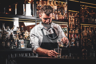 Sticker Diligent serious barman is preparing alcoholic beverege for customer.
