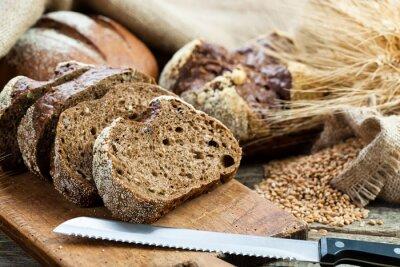 Sticker du pain frais et du blé sur le bois