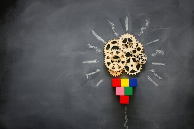 Sticker Education concept image. Creative idea and innovation. Wooden gears light bulb metaphor over blackboard