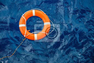 Sticker Équipement de sécurité, bouée de sauvetage ou bouée de sauvetage flottant sur la mer pour sauver les gens contre les noyades.