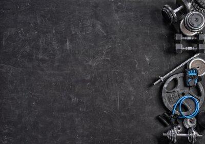 Sticker Équipement de sport sur fond noir. Vue de dessus. Motivation