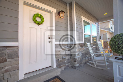 Sticker Facade of a home with a simple wreath hanging on the white wooden door
