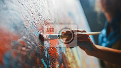 Sticker Female Artist Works on Abstract Oil Painting, Moving Paint Brush Energetically She Creates Modern Masterpiece. Dark Creative Studio where Large Canvas Stands on Easel Illuminated. Low Angle Close-up