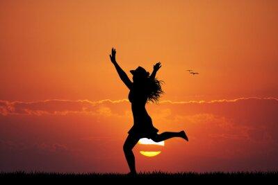 Sticker fille heureuse au coucher du soleil