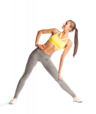 Sticker Fitness femme faire de l'exercice, en souriant et en regardant isolé sur fond blanc