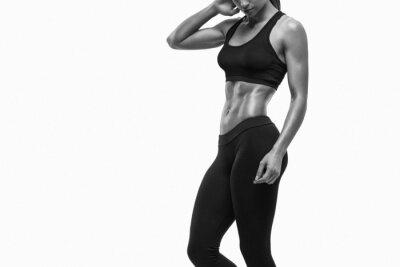 Sticker Fitness femme sportive montrant son corps bien formé