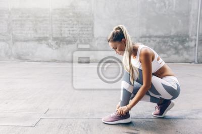 Sticker Fitness sport woman in fashion sportswear doing workout over gray wall