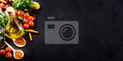 Sticker Food background. Top view of olive oil, cherry tomato, herbs and spices on rustic black slate. Colorful food ingredients border.