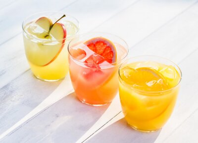 Sticker Fresh fruit juice from oranges apples pink grapefruit