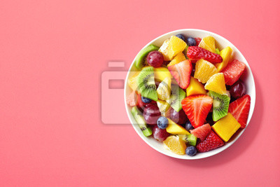 Sticker Fresh fruit salad on pink background