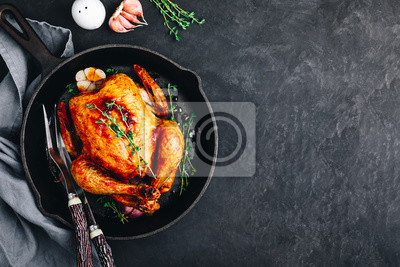 Sticker Grilled fried roasted whole Chicken in cast iron pan
