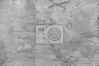 Gris surface de peigne de plâtre de colle murale préparé pour carrelage