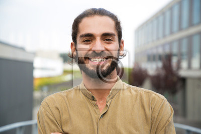 Sticker Handsome happy bearded man. Portrait of cheerful young man standing outdoors and smiling at camera. Emotion concept