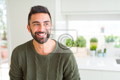 Sticker Handsome man smiling cheerful with a big smile on face showing teeth, positive and happy expression