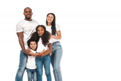 Sticker happy african american parents with daughter and son smiling at camera while standing isolated on white