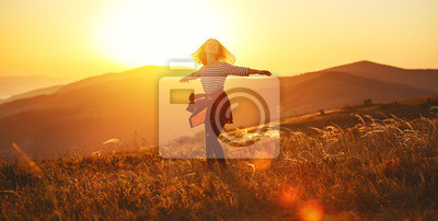 Sticker Happy woman jumping and enjoying life  at sunset in mountains.