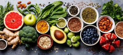 Sticker Healthy food clean eating selection: fruit, vegetable, seeds, superfood, cereal, leaf vegetable on gray concrete background