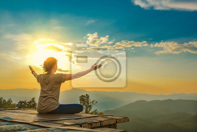 Sticker Healthy woman lifestyle balanced practicing meditate and zen energy yoga outdoors on the bridge in morning the mountain nature. Healthy life Concept.