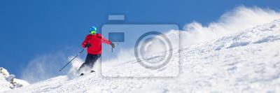 Sticker Homme de ski sur la pente préparée avec de la neige fraîche et fraîche.