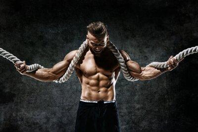 Sticker Homme musclé avec une corde. Photo d'un homme avec un corps parfait après l'entraînement. Style de mode