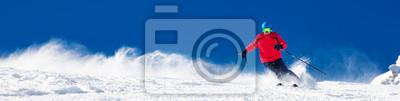 Sticker Homme skiant sur la pente préparée avec de la nouvelle poudreuse