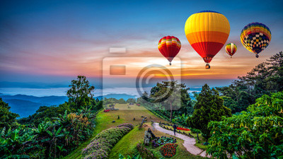 Sticker Hot air balloons adventure in nature over winter mountain in Chiang Mai, Thailand.