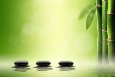 Sticker Le concept Zen. Pierres spa noirs dans une forêt de bambous.