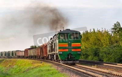 Sticker Le train de marchandises tracté par locomotive diesel. Ferroviaire biélorusse