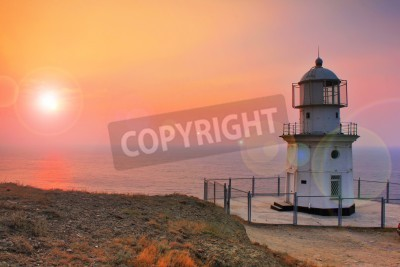 Sticker Lighthouse on the coast at dawn