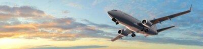 Sticker Moderne vol d'un avion de passagers dans Sunset Panorama