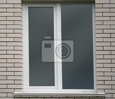 Mur de briques blanches et fenêtre