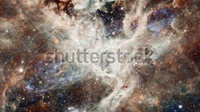 Sticker Nébuleuse nuit ciel étoilé en couleurs. Espace extérieur multicolore. Espace lointain à de nombreuses années-lumière de la planète Terre. Éléments de cette image fournie par la NASA