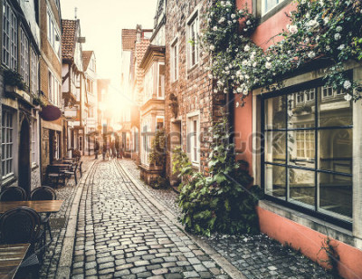Sticker Old town in Europe at sunset with retro vintage Instagram style filter effect