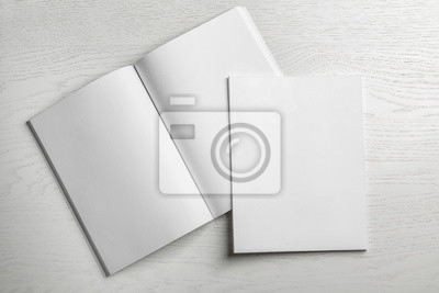 Sticker Open and closed blank brochures on wooden background, top view. Mock up for design