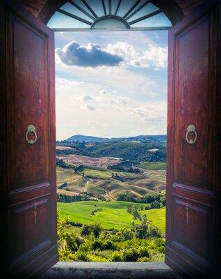 Sticker Ouvrir la porte et le paysage