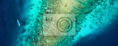 Sticker Panoramic view on the coral reef and boat. Azure water background from top view. Summer seascape from air. Travel - image