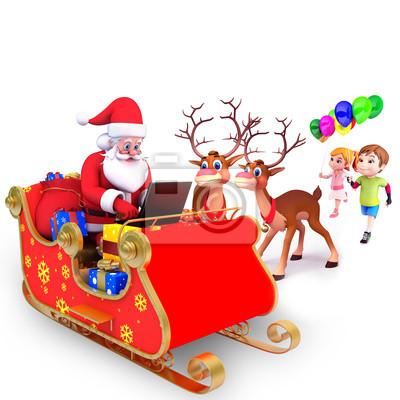 Père Noël avec des rennes et ordinateur portable