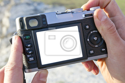 Photocamera dans une main