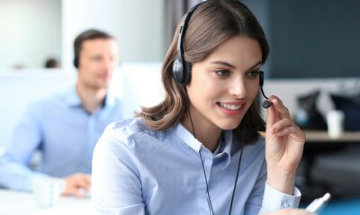 Sticker Portrait of call center worker accompanied by his team. Smiling customer support operator at work.