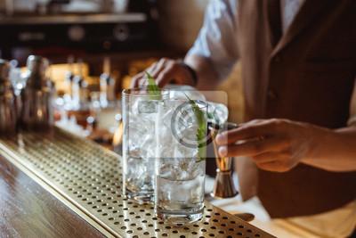Sticker Prepairing gin and tonic at the bar