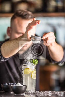 Sticker Professional barman making  alcoholic cocktail drink with fruits sugar and herbs